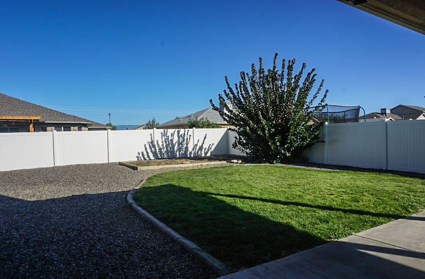 The large back yard at 2995 Golden Hawk has a garden area