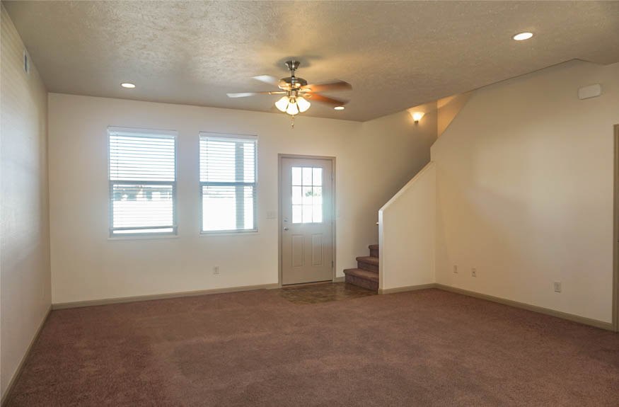 living room of 2995 golden hawk has access to the upstairs, a half bath, and the covered back patio