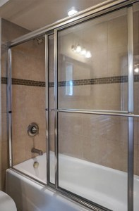 The in-tub shower has a sliding shower door