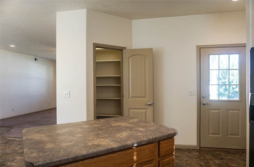 Access to the back patio & side yard from the kitchen of 2995 Golden Hawk