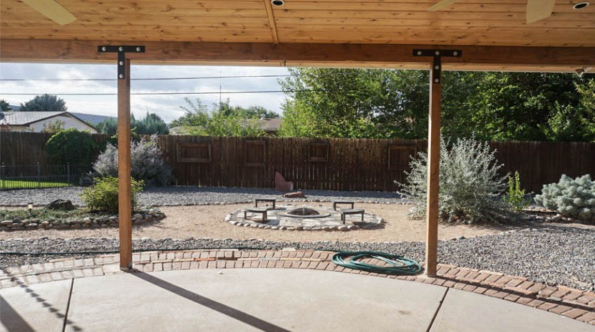 Looking through the back patio to the firepit at 535 Oriole Drive on the Redlands