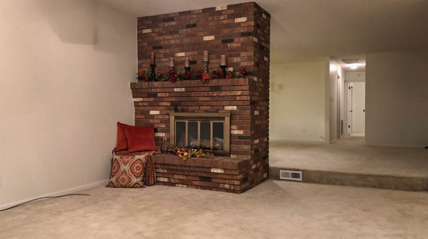 Fireplace in the den of 535 Oriole