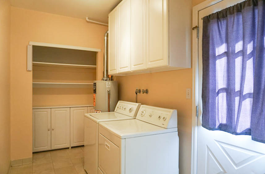 Laundry room with linen closet & cabinets in 535 Oriole Drive
