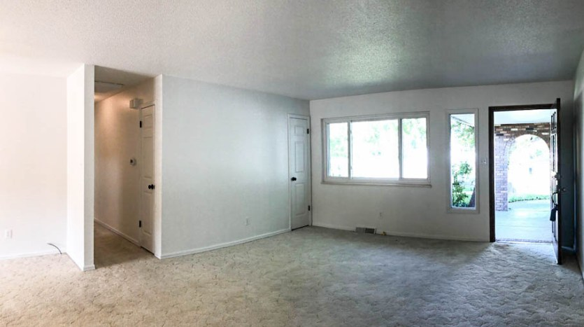 The living room has large windows looking east