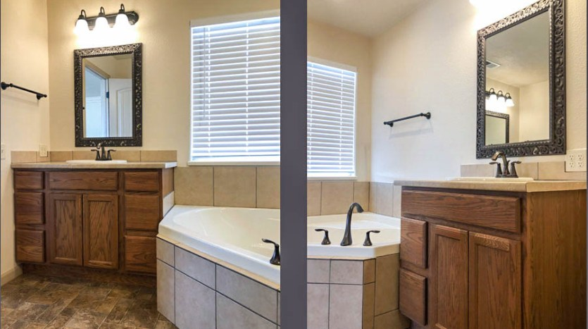 The Master Bath has double vanities on either side of the corner soaking tub.