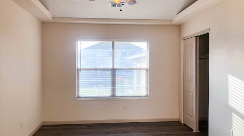 The 3rd bedroom of 164 Winter Hawk can be used as an office, formal dining room, or a bedroom. It has glass french doors, and access to the walk-through hall bath.