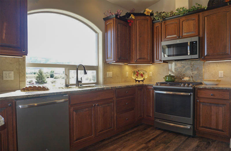 Kitchen Styles: Traditional style kitchen incorporate raised panel cabinetry, natural stone countertops, decorative moldings and corbels.