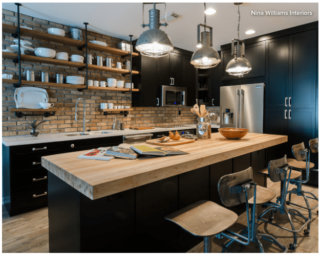 Kitchen Styles: Industrial Kitchen Style includes the use of old brick, black metal, and dark cabinets. Often found in old warehouse building that have been converted into apartments.