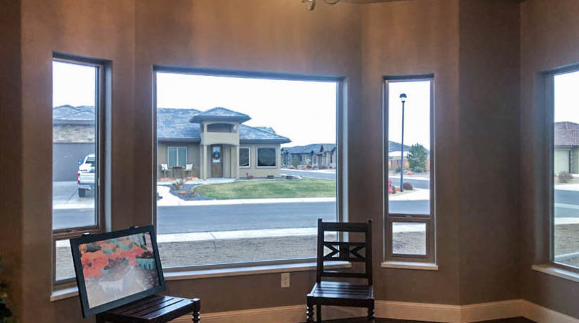 The dining area of 1329 Niblick Way, Fruita has an east-facing bay window, and south facing picture window to capture the views.
