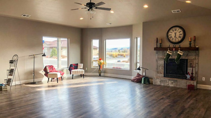 the living room of 1329 Niblick Way has large picture windows to let in natural light and capture the incredible views of the Colorado National Monument and Grand Mesa.