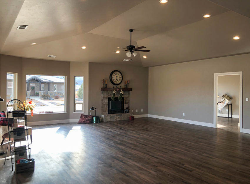 Living room of 1329 Niblick Way in Fruita features gorgeous views to the south and east, and a gas fireplace with a custom mantle and tile work.