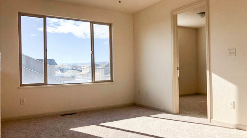 The family room has large windows to let in natural light and the east window offers a fantastic view of the Grand Mesa!