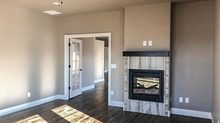 There is a two-sided gas fireplace between the living room and bonus/office in 1305 Niblick Way