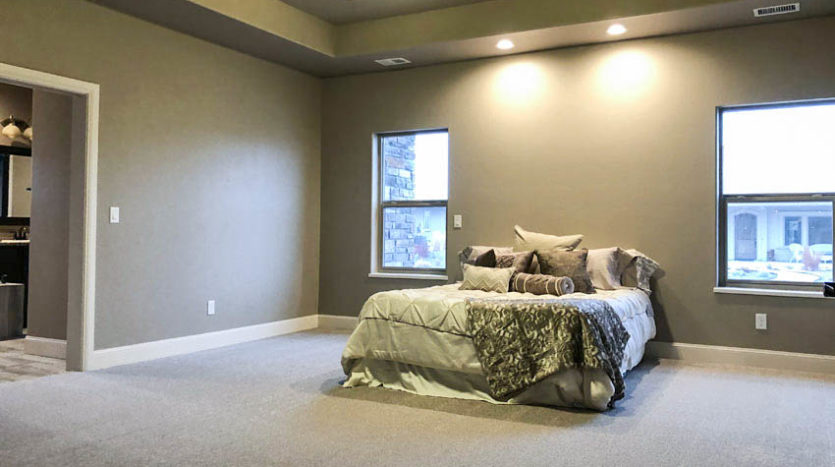 The master bedroom in 1305 Niblick Way is quite large, with space for a bed plus dressers, chairs, and more!