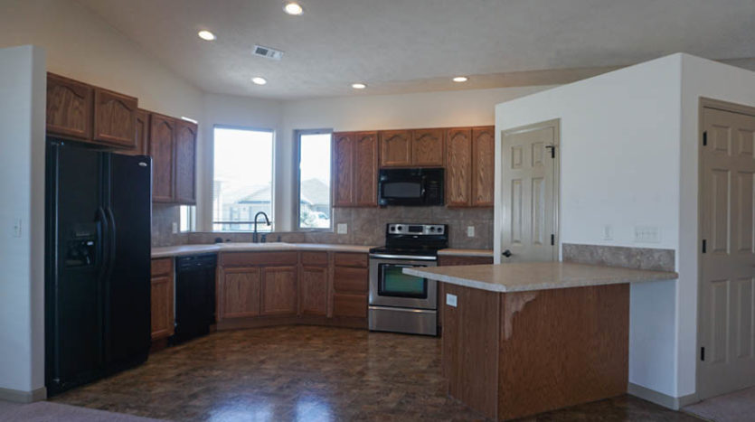 The kitchen of 187 Sun Hawk includes all appliances.