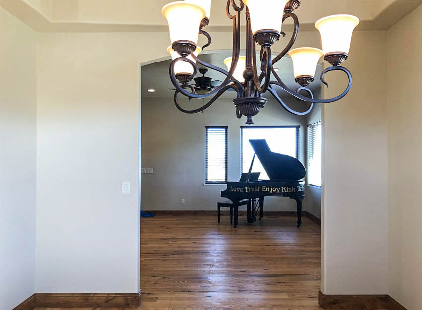 The formal dining room is accessible through an arched opening from the living room.