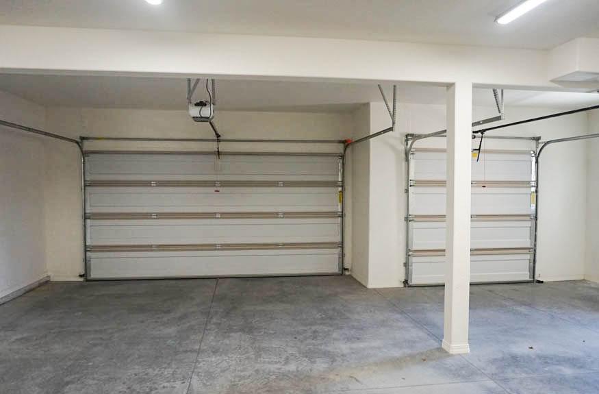The oversized 3-car garage in 1485 Adobe Falls Way.
