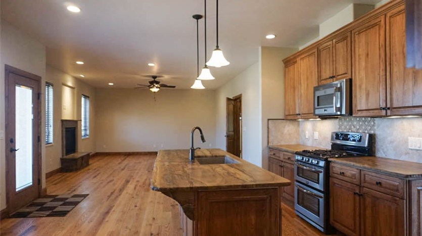 The kitchen flows into the den or family room area.