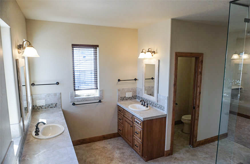 A top down view of the vanities and private toilet room of the master bath of 1485 Adobe Falls Way.