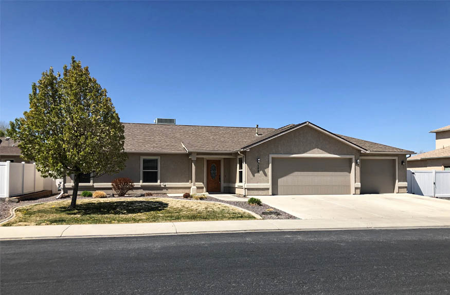 183 Winter Hawk Drive is a 4 bedroom, 2 bath home with a 3-car garage and RV parking located in Hawks Nest Subdivision.