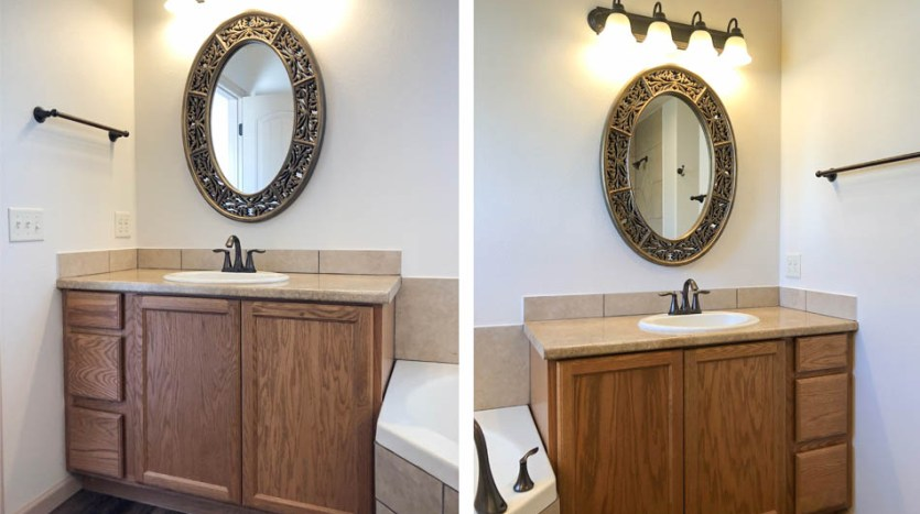 Separate vanities flank the corner soaking tub in 183 Winter Hawk Drive