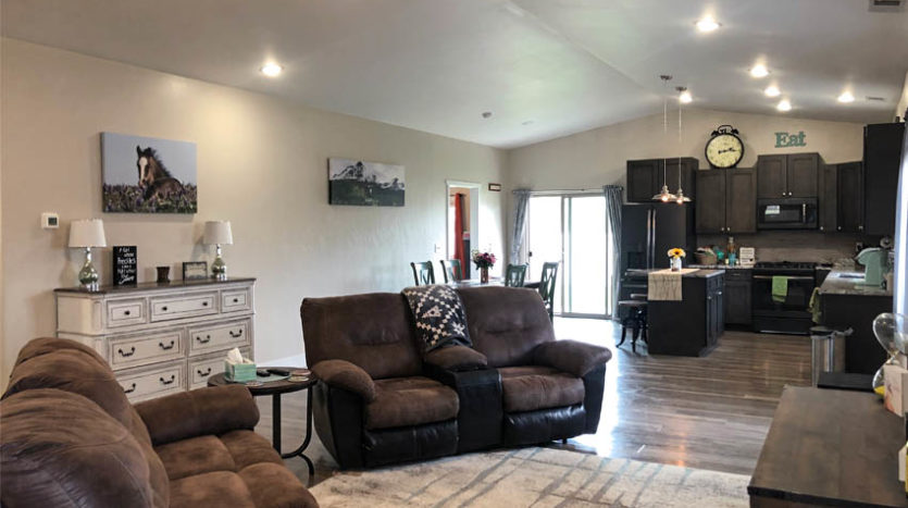 The living area is set up as a great room, with the kitchen & dining at the north end, and the living room to the south.