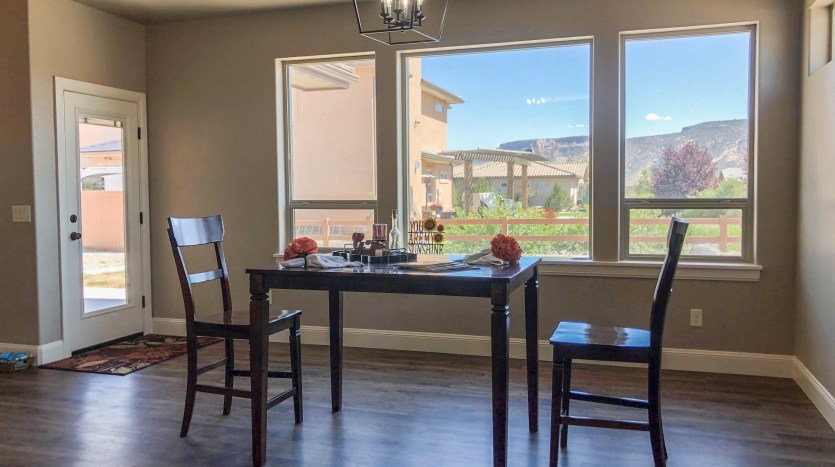 The dining room offers easy access to the covered back patio.