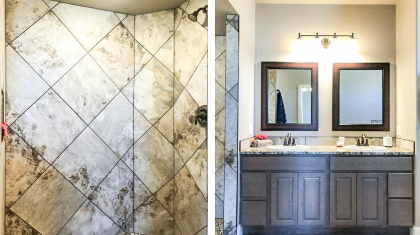 1484 Shoreline's master bath has a roll-in shower, double sink vanity, soaking tub, and toilet.