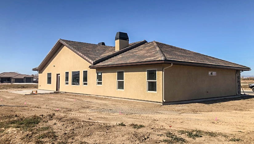 The back of 1404 Shoreline Drive in Fruita has been partially landscaped and has a concrete patio off of the living area.