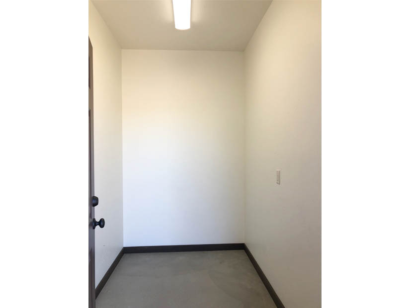 The attached storage room on the west side of 1404 Shoreline Drive.