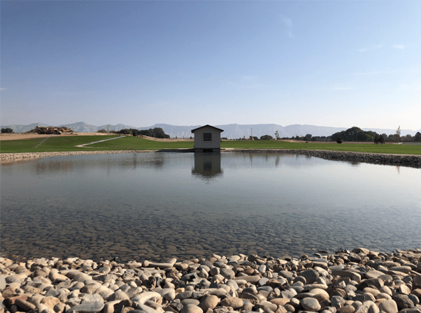 Photo of the large pond located in the main park area of Emerald Ridge Estates.