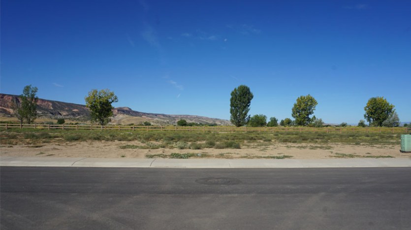 1303 Fairway Drive is a 0.33 acre lot on the west perimeter of Adobe Falls Subdivision.