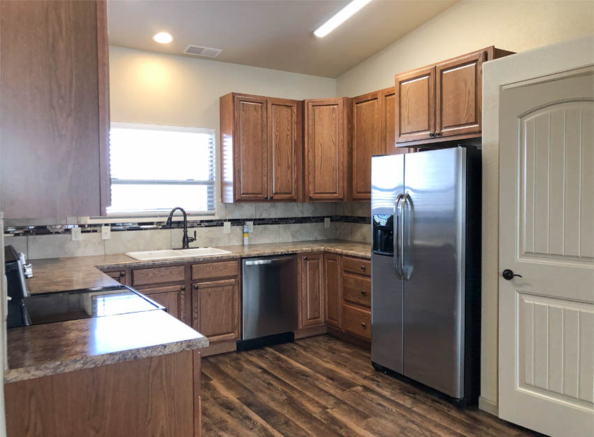 The u-shaped kitchen of 2989 Black Hawk Way includes all appliances and a walk-in pantry.