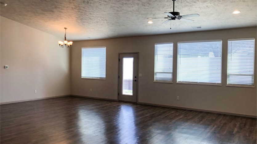 the living and dining rooms of 2989 Black Hawk Way.