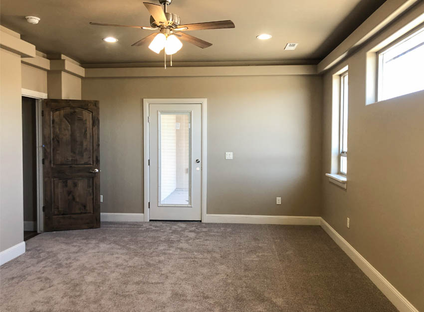 The master bedroom of 852 has access to the covered patio on the east of the home.