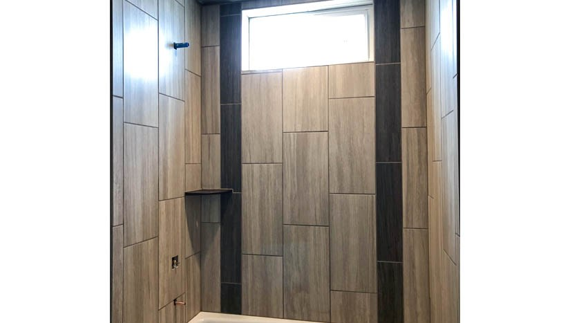 The hall bath of 853 Fire Agate has custom tile work, with an operable window to allow for light and air movement