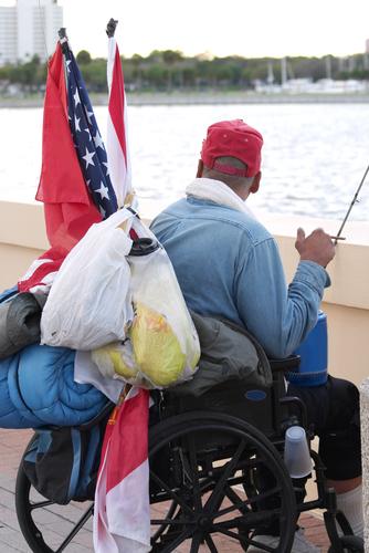 A homeless veteran in a wheelchair.