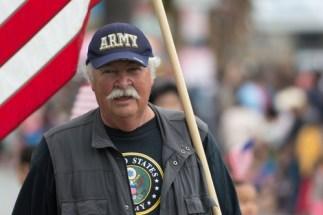 Canoga Park, CA, USA - May 25, 2015: Military veterans holding flag during parade