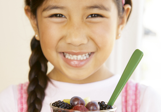 Girl holding fruit cup