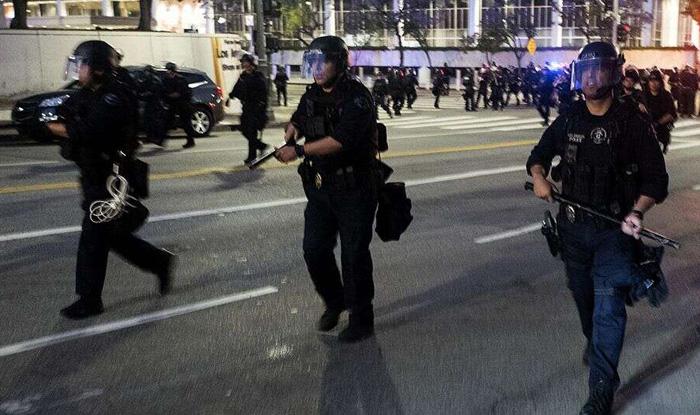 DOJ makes death investigation a 'top priority' after violent protests grip Minneapolis