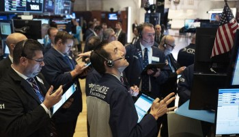 Stocks soar to record highs as coronavirus vaccine hopes build