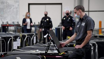 The Small World of Voting Machine Certification