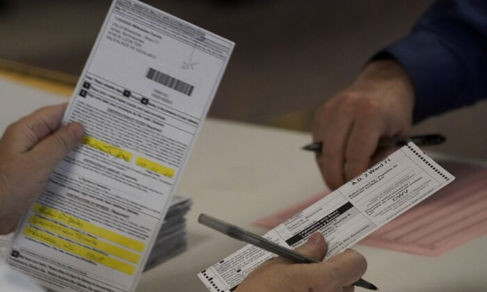 """The Wisconsin Elections Commission on Wednesday night issued an order to recount ballots in two counties following a request by President Donald Trump's campaign. Commissioners in a video teleconference on Wednesday argued for nearly six hours before ultimately agreeing to conduct the recount. """"An order will be issued mandating that the recount take place. This is not a discretionary decision. This is simply what will happen,"""" Chairwoman Ann Jacobs, a Democrat, said at the beginning of the hearing. But members of the commission, which has three Republicans and three Democrats, debated for hours over how the recount would be conducted. Some said state law governing a recount contained ambiguities. Republican Commissioner Dean Knudson said he believed the commission should issue guidance to canvassers that they should set aside ballots that had a correction made to the witness address. """"They've essentially filed in advance a mass objection to all such ballots, that in this era of pandemic, and all our concerns for public health, and so on, it's kind of ridiculous to have the observers have to be close enough to see each one and object individually to each one, when instead, we could give guidance at the outset that says, 'hey, those need to be set aside, because those are going to be under litigation,'"""" Knudson said. """"I don't necessarily think that as a commission, we should be pre-determining what ballots are going to be questioned or what envelopes are going to be questioned. That's not our position,"""" Democrat Commissioner Julie Glancey said, though the Republican Party of the Trump campaign could recommend canvassers do so. Wisconsin Counts Poll workers check-in a box of absentee ballots at Sun Prairie High School in Sun Prairie, Wisconsin, on Nov. 3, 2020. (Andy Manis/Getty Images) Knudson sparked stronger pushback when he wondered whether clerks sent out thousands of ballots that weren't requested by voters as he proposed including written applications in the rec"""
