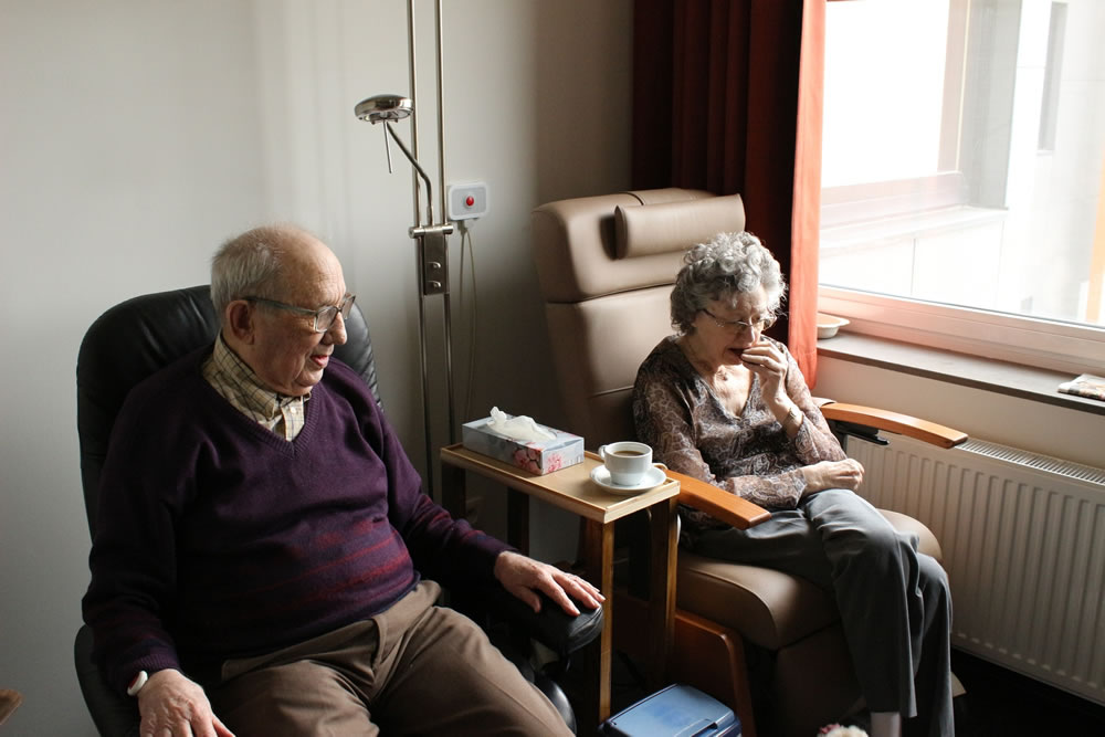 A man and a woman sitting on a chair