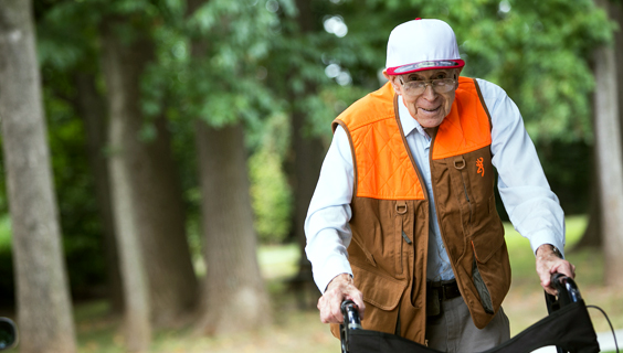 Older man using a walker to prevent falls
