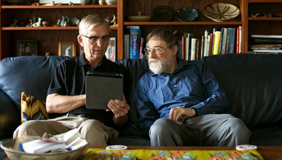 2 older men looking for health information online