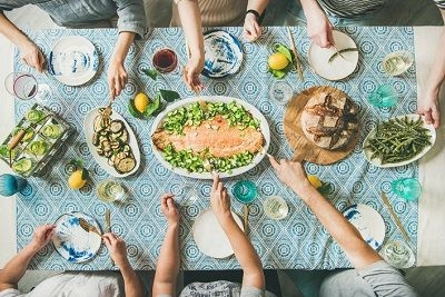 people around a table of food