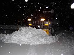 XJ plowing snow.