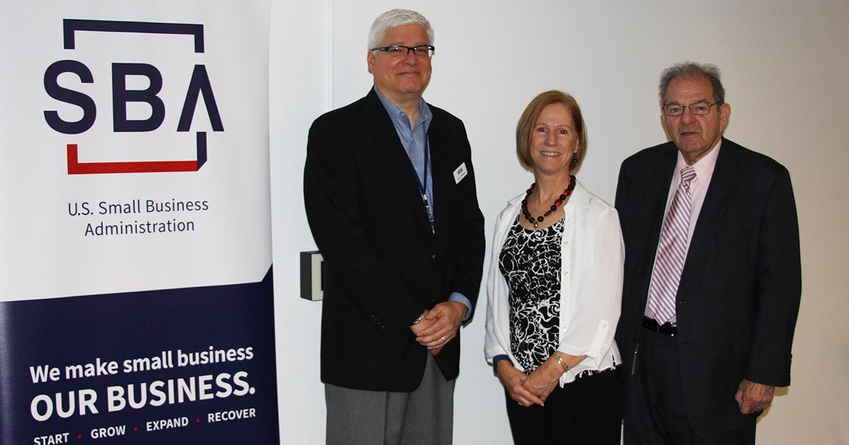 Small Business Association (SBA) representatives with SBDC Director Lynn Oswald (center)
