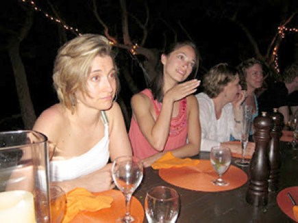 At a secret week long gathering in Necker Island, NXIVM women imbibe liquor and learn the secrets of their master, Keith Raniere. If the two women closest to the camera look familiar it is because you may have seen them on TV; They are actresses Kristin Kreuk and Allison Mack, longtime devotees and purported harem members.